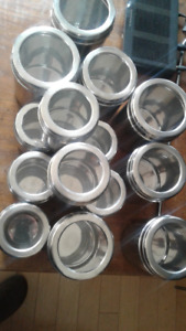 14 stainless steel canisters with see through lid.