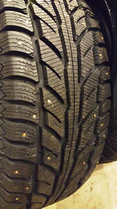 4 X new jeep winter studded tires on rims. not used. REALLY NEW