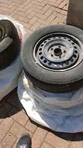 Michelin P205/65R15 tires and steel rims