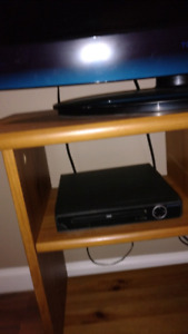 tv, stand and dvd player