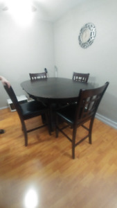 Dark wood pub style dining table with 4 chairs
