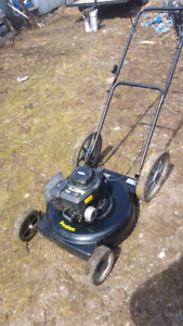 Poulan high wheeler gas mower.