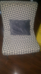 Modern accent chair from Bouclair. Light gray in color