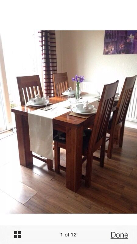 DFS Shiraz solid wood dining table and four chairs | in Southam ...