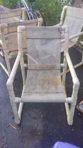 4 plastic patio chairs and table free taken pending pickup.