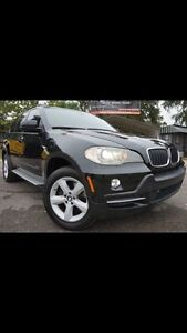 2007 BMW X5 ( fully loaded with navigation and DVD, 7 passenger)