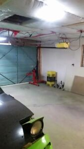 DOUBLE CAR GARAGE WITH BACK ALLEY - LOCATED JUST OFF CENTRE ST.