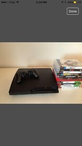 Playstation 3 + controller and charger with 11 games