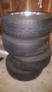 Used tires with rims and cap