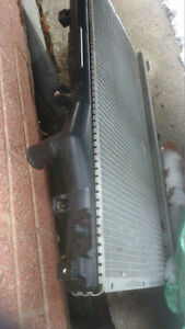 98 NEON PARTS---NEW RADIATOR-50 ----FANS --- AND MIRROR