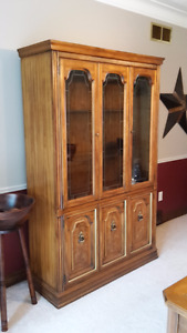 Wooden hutch with glass shelves and bottom cupboards