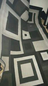 Black square area rug