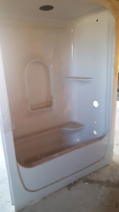One piece shower and tub