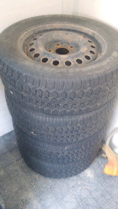 4 winter tires 225/60R16 mounted on rims