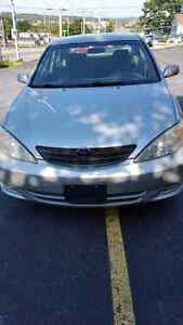 2004 Toyota camry LE. 4 cly