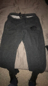 Black, ladies size small roots pants. have pockets