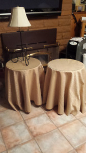 Two Pressed Wood Tables Including Table Clothes & glass Toppers