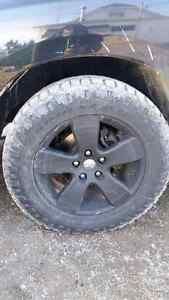 """20"""" tire and rim combo off a ram truck."""