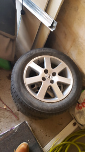 2 OEM acura rims with tires