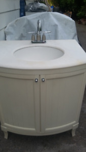 Bathroom vanity with stone marble top and tap