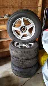16x7 core racing rims with all seasons  tires