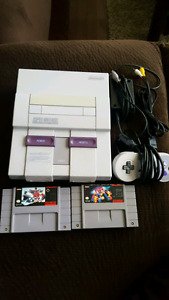 Snes 2 games and 1 controller.