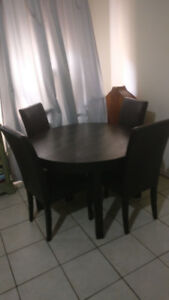 black BJURSTA table and matching chairs -$280
