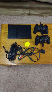 PS2 with 2 controllers, 1 memory card, 5 games