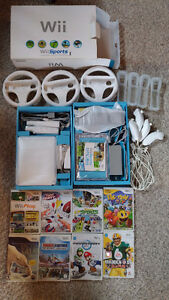 Nintendo Wii Sport console + 4 controllers + 3 wheels + 9 games