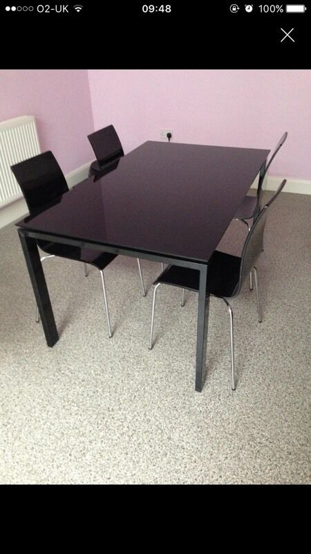 """Black glass table with 6 chairsin Barking, LondonGumtree - Excellent condition, 6 chairs. Pick up only. Width 36"""". Length 59"""". Height30"""""""