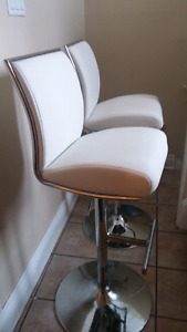 Two white bar stools. Never used