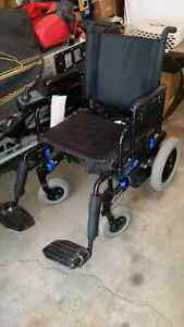 Electric power wheelchair and charger.