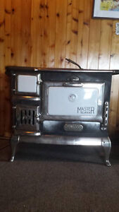 Early 1900's old cast iron wood / cook stove