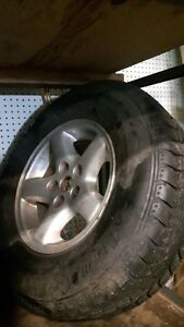 4 235 75 15 TIRES ON JEEP RIMS BOTH IN VERY GOOD COND
