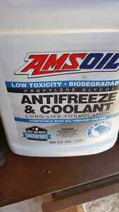 For sale amsoil antifreeze coolant and 2 Metal gas cans