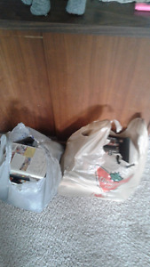 Two Grocery Bags of DVD Movies Assortment