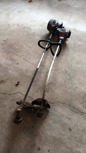 Two Craftsman gas weed trimmers