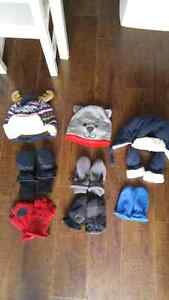 Assorted winter hats and mittens
