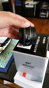 40 mm f/2.8 canon lens with 52 mm Polaroid lens filter