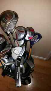 Smorgasbord of golf clubs left and right with bag