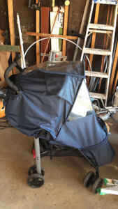 ubini light stoller with rain cover and foot muff