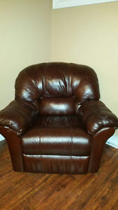 moving sale. High quality solid leather recliner