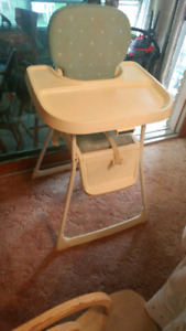 Highchair and playpen and activity center