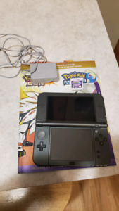Nintendo 3ds with pokemon moon and strategy guide $220 OBO