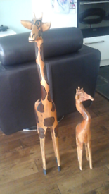 Pair of hand carved solid wood giraffes
