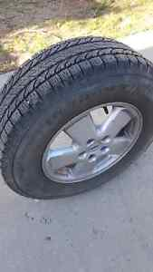 235 70r16 winter tires mounted on Alloy wheels