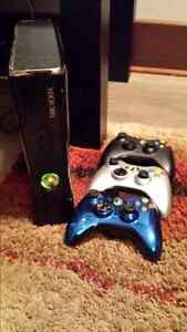 Xbox 360, 3 controllers, headset and box.