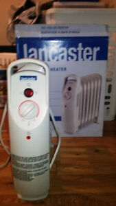OIL FILLED HEATERS - 1 NEW IN BOX. Save power & Yet Powerful.