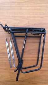 Brand new Topeak super tourist DX rack - spring, black