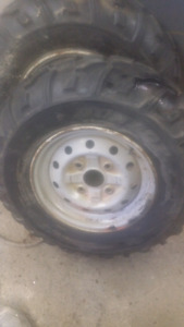 AT 25 x 8 x 12 Atv tires on rims.